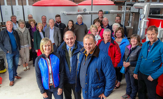 Park Foot co-owner Fiona Bell (front left) with BH&HPA Chairman Henry Wild (middle), and Keith Campbell of Argyll Holidays (front right) with a delegation of Scottish park operators on a visit to see Park Foot's new biomass heating system from Osby Parca and Bio-Geo.